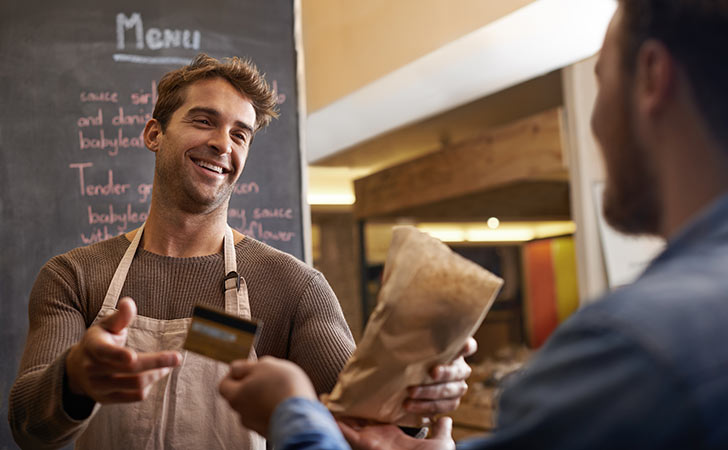 barista taking card from customer